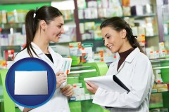 colorado map icon and two pharmacists in a drug store