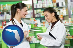 florida map icon and two pharmacists in a drug store