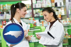 north-carolina map icon and two pharmacists in a drug store