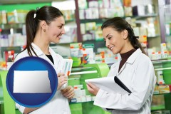 north-dakota map icon and two pharmacists in a drug store