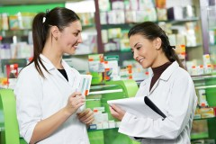 two pharmacists in a drug store