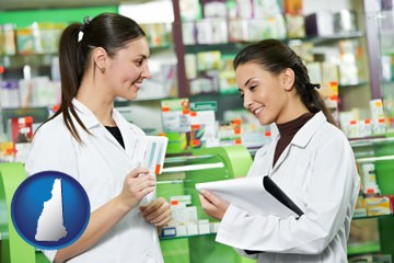two pharmacists in a drug store - with New Hampshire icon