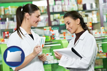 two pharmacists in a drug store - with Oregon icon